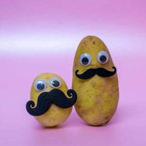 funny potato head with a face on a pink background