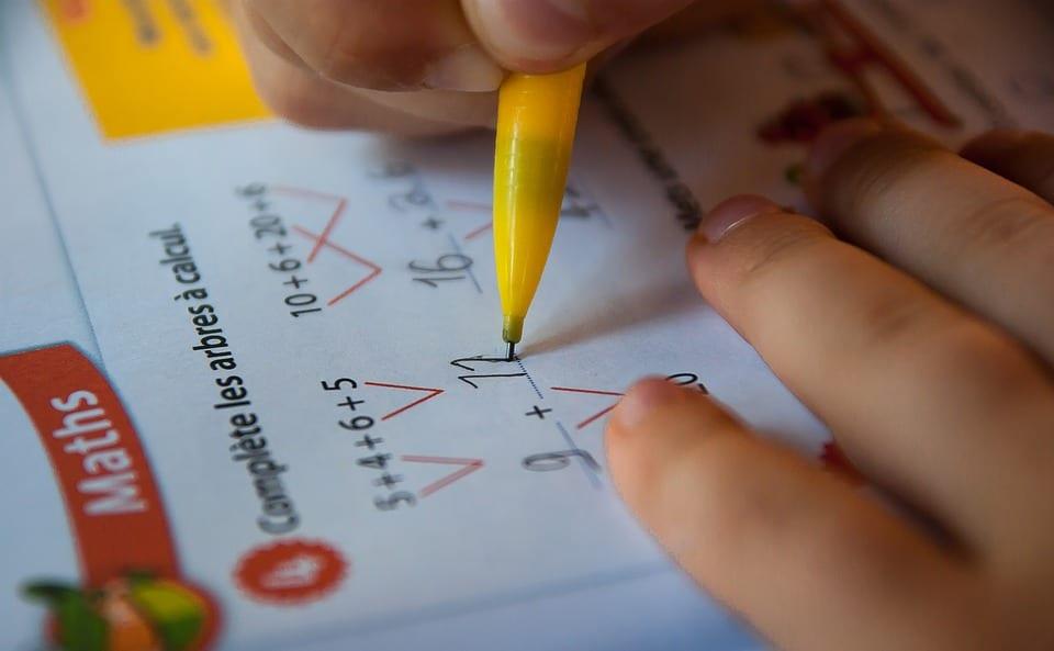Maths image showing a child writing