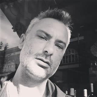 Selfie of Ben Preston in black and white.