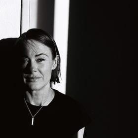 black and white portrait image of Siobhan Bradshaw smiling