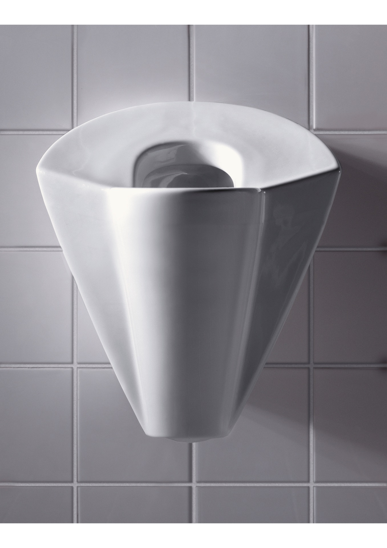 lady p female urinal in white ceramic on white tiled wall.