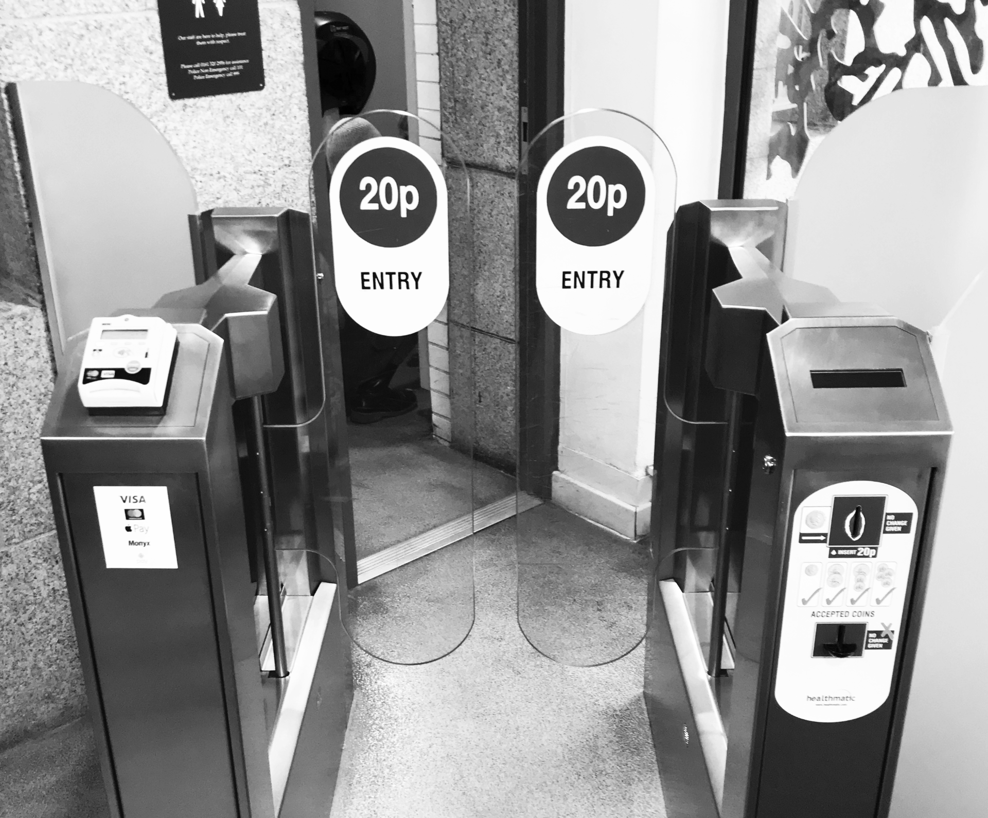 Paddle gate entry system, card reader on left-hand side, coin payment on right-hand side.