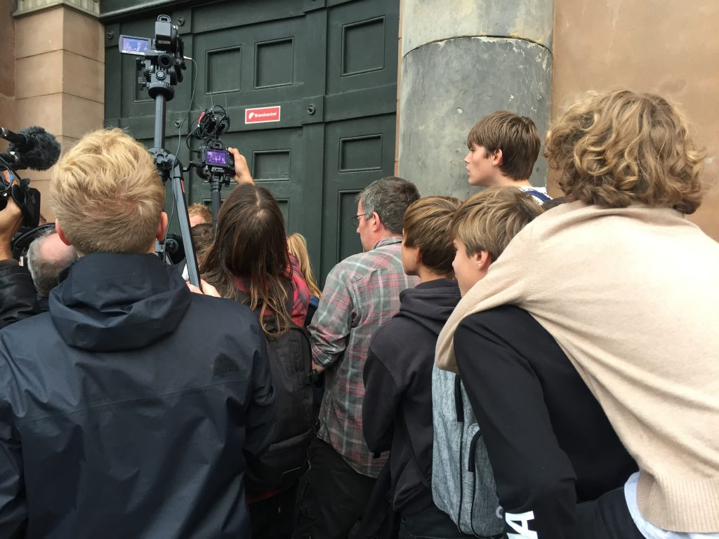 Youths straining to see Prosecutor, Jakob Buch-Jepsen giving a statement to the media. Photo: Lucy Samson