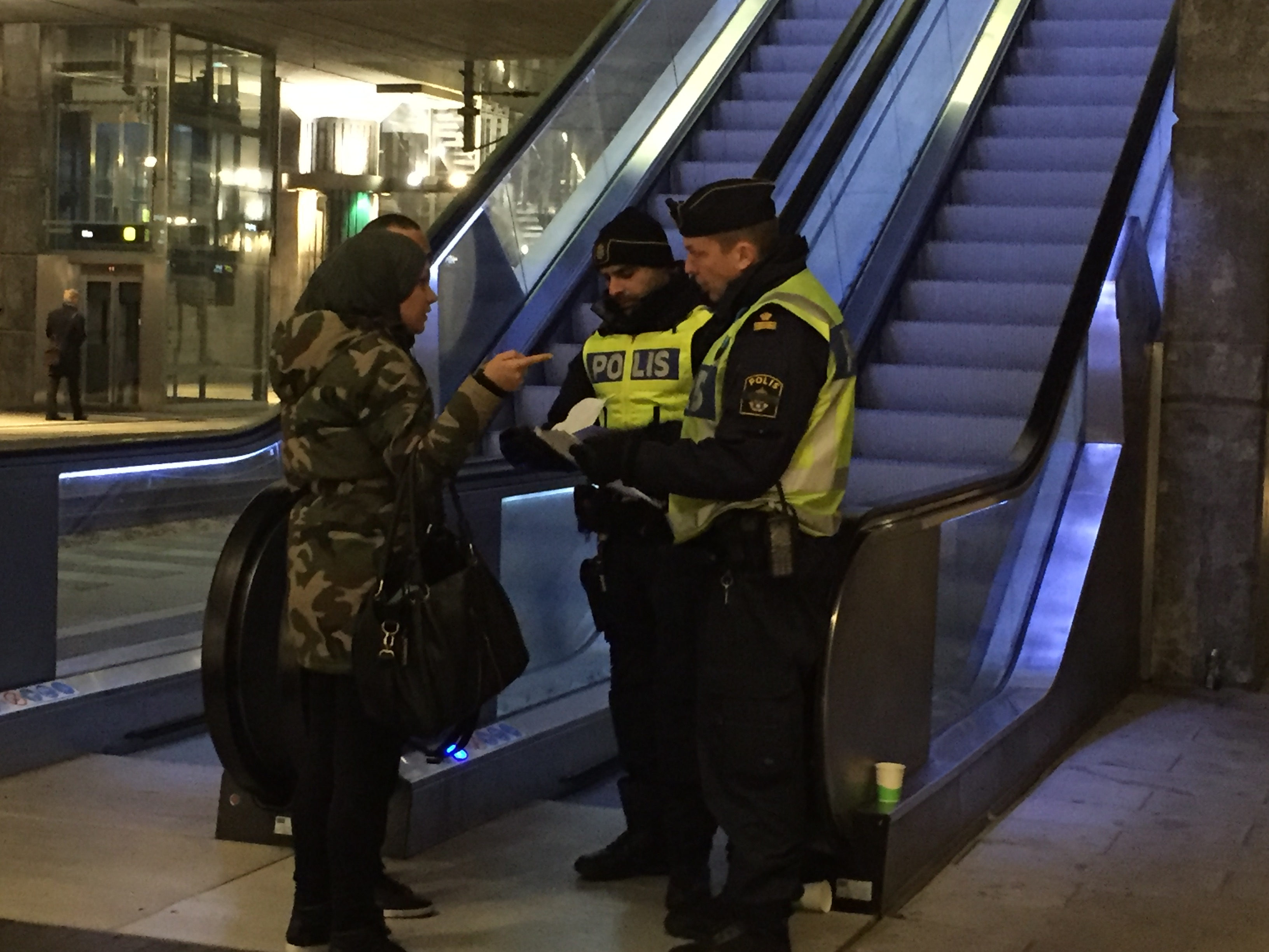 Police check documents of people arriving at Hyllie Station, Malmo, Sweden, 26 November, 2015