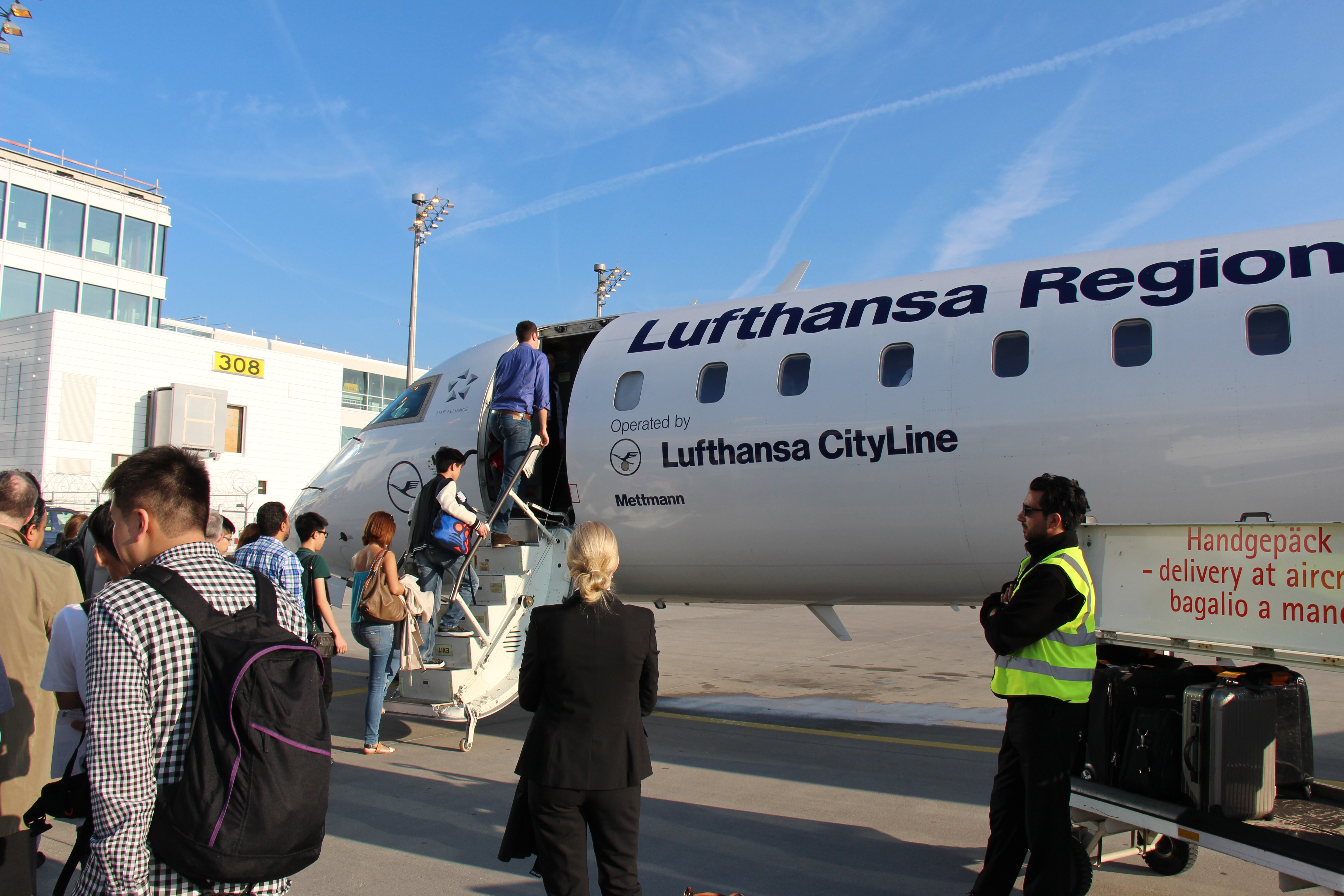 Some 40 Hong Kong journalism students transit from Munich to Leipzig for an hour-long domestic flight.