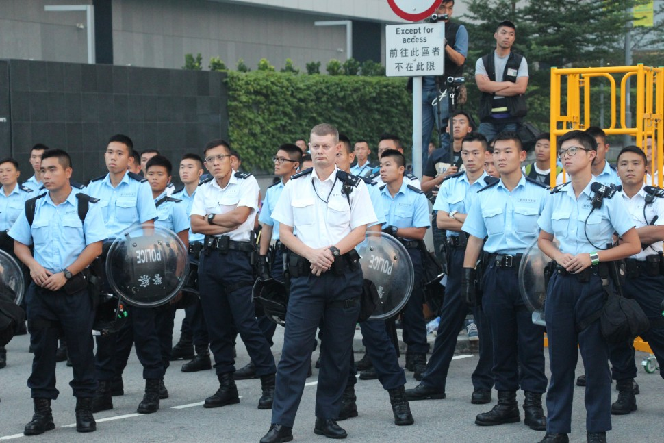 Stand-off between police and protesters near police headquarter during Umbrella Movement in 2014.